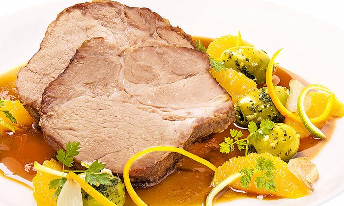Schweinebraten mit Orangen und Oliven